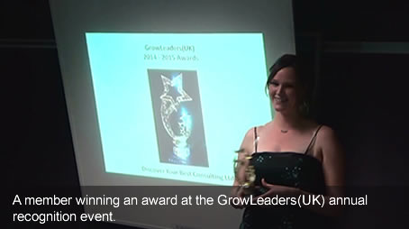 A member winning an award at the GrowLeaders (UK) annual recognition event